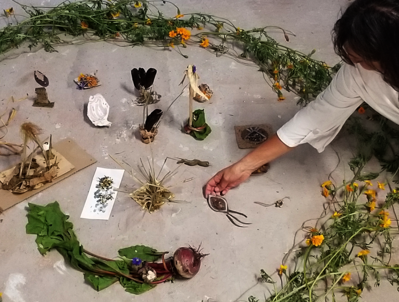 A collection of biodegradable artworks created during a public workshop.